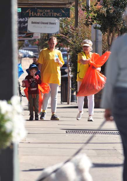 Greater Grass Valley Chamber of Commerce's Robin Davies (right), Kristin Glauner and her four year old son Kadence don their yellow shirts as they take part in Saturday morning's Random Acts of Kindness Event.