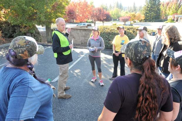 Former Grass Valley Chief of Police John Foster instructs a team of RAKE members as they prepare to set out along Sutton Way and Idaho Maryland Road.