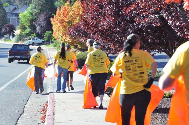 An army of RAKE members take to the streets of Grass Valley Saturday morning, cleaning up various sections of the city in teams.