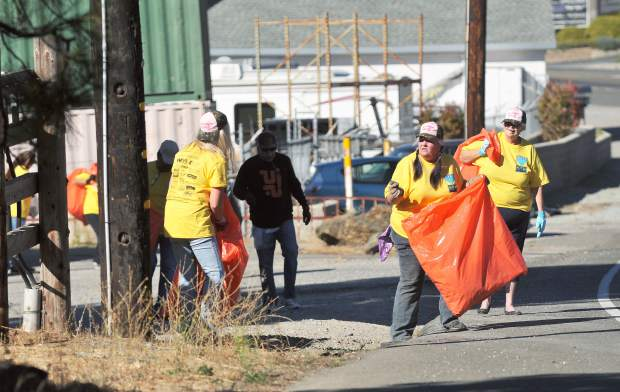Random Acts of Kindnes Event, aka RAKE, members scoured the community Saturday morning in search of trash to put into bright orange bags during the annual beautification event.