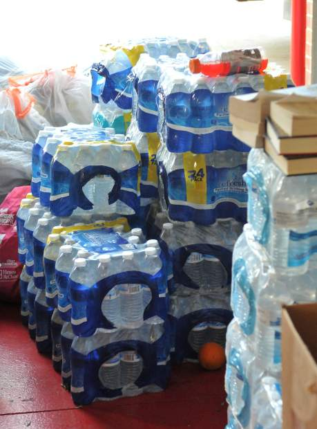 Cases of bottled water are some of the many items that have been brought to the Rough and Ready Fire house. Other items that have been donated include clothes, pet supplies, beds, and even a house.