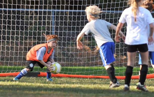 Eight year old goalkeeper Henry Seward makes a save for the Speeding Falcons during Saturday's matchup against The Champions.