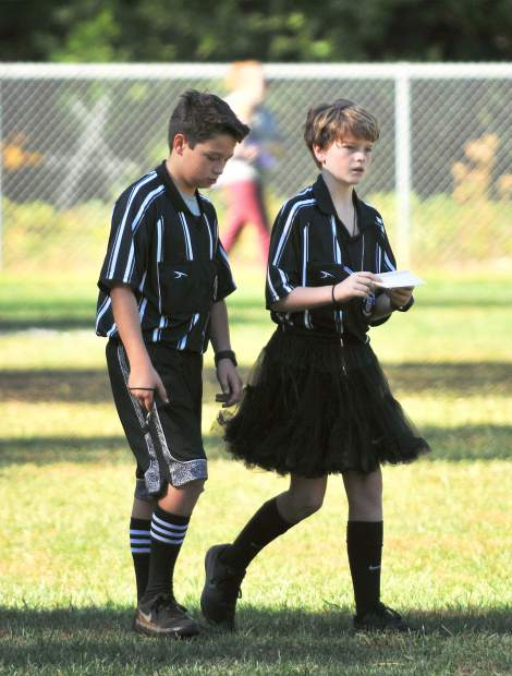 Youth referees and friends Maxson DeFeyter (left) and Reyn Smith convene after a game.