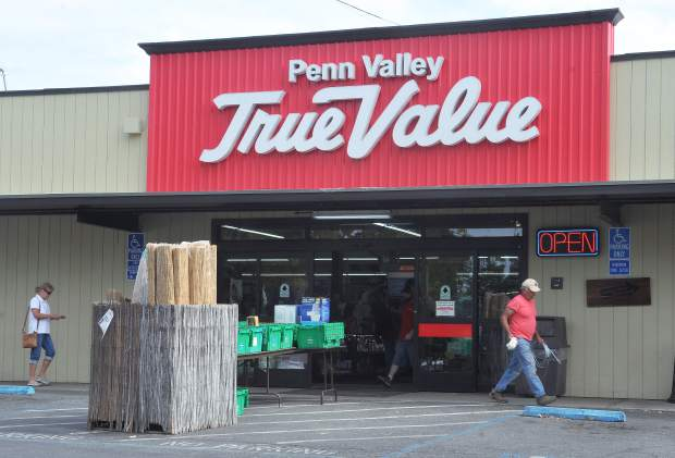 Shoppers enter and exit the Penn Valley True Value Hardware store, one of the county's largest tax revenue generators.