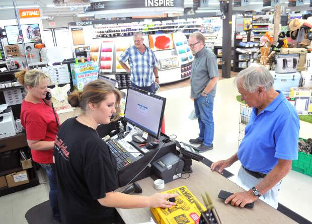 Penn Valley True Value Hardware employee Trenidy Dickinson helps customers last week. The hardware store is one of the larger tax revenue generators in the county.