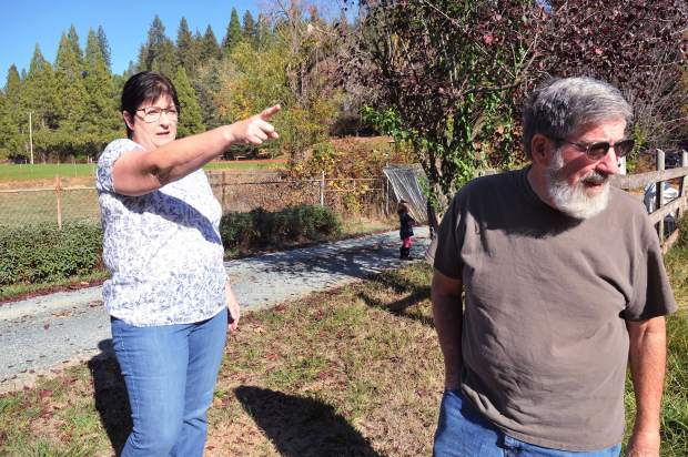 Shannon Friedberg and husband Steve Nightingale point out a portion of their property that they think may succumb to the widening of Highway 174.