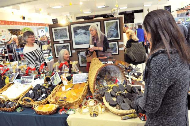 Early holiday shoppers peruse the collections on display by the Banner Mountain Artisans at the Nevada City Elks Lodge Saturday.