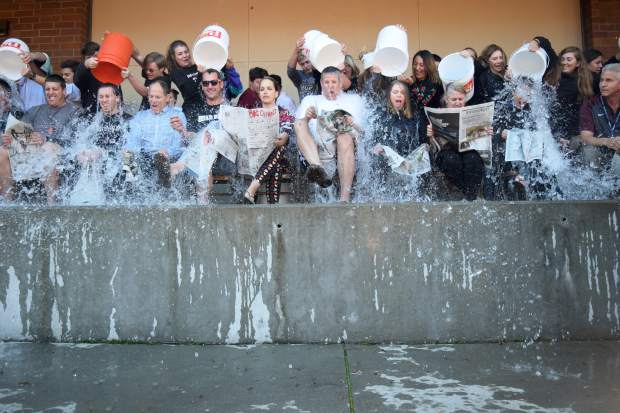Bear River High School faculty members received a splash down to show support of the Bear River Current newspaper staff members raising funds to attend the High School Journalism Convention in San Francisco.