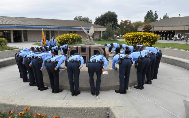 CHP cadets take part in the weekly fountain ceremony, where they polish and maintain the academy's memorial to the more than 200 CHP officers that died in the line of duty.