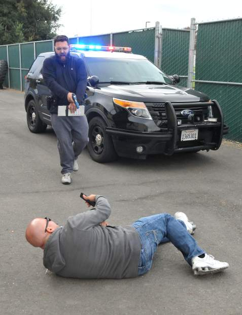 A traffic stop suspect lays on the ground after being shot by media boot camp cadet Frankie Tovar with Simunitions ammunition during last weeks' CHP media boot camp held for members of the media at the West Sacramento training academy. Tovar, content manager for the Turlock Journal, thought the suspects cell phone was a gun. The event was held to give members of the media an added insight into the training and decision making that goes into becoming a CHP officer.