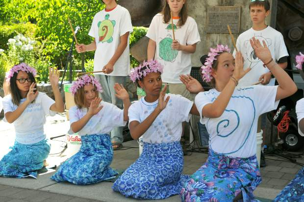 Climate Change Agents campers sing and perform a dance during the Nevada City Farmer's Market Saturday morning.