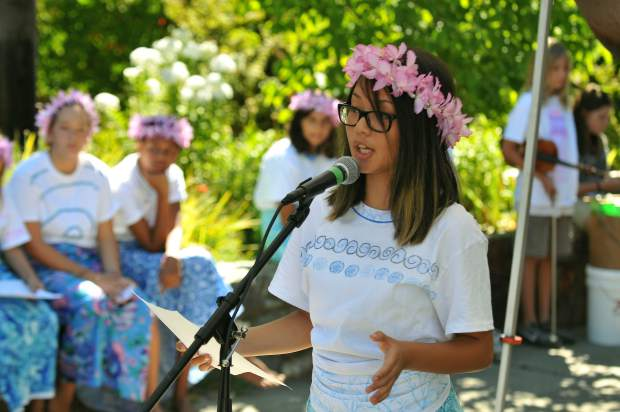 Climate Change Agents campers sing and perform during the Nevada City Farmer's Market Saturday morning.