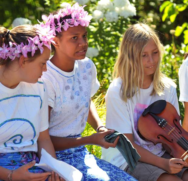 Campers working on becoming change agents, including Vanuatu's Rosana Kalulu (second from left) ready to perform song and dance during the Nevada City Farmer's Market.