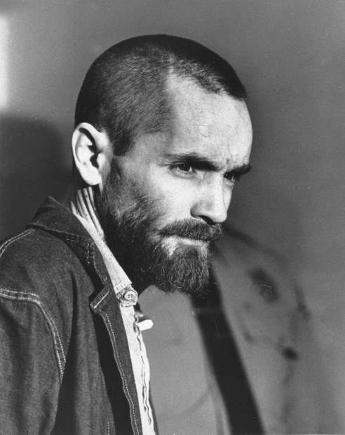 FILE - In this March 5, 1971 file photo, Charles Manson arrives in a courtroom in Los Angeles, Calif. Authorities say Manson, cult leader and mastermind behind 1969 deaths of actress Sharon Tate and several others, died on Sunday, Nov. 19, 2017. He was 83. (AP Photo, File)