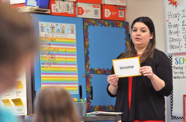 Grass Valley Wells Fargo branch manager Nicole Box teaches Chicago Park Elementary third graders what income is during Thursday morning''s junior achievement program. Around 15 Wells Fargo associates from the region assisted with the program that aims to teach kids the basics of personal finance.