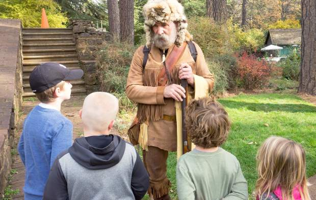 George Steger portrayed Joseph Walker, an 1833 mountain man, who took the time to talk with young visitors during Holidays at Empire Mine Saturday morning.