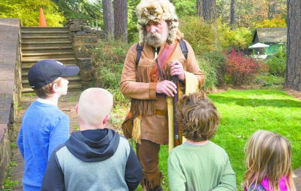 Photo by John Hart George Steger as Joseph Walker a 1833 mountain man, talking to kids at the Holidays at Empire Mine, Saturday morning.