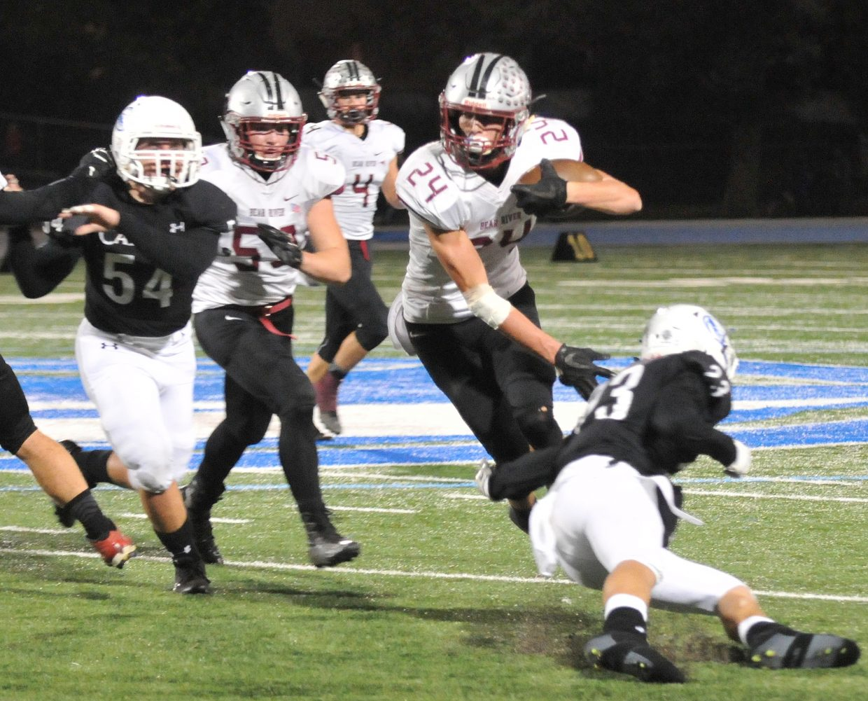 Bear River's Tre Maronic (24) makes his way through Capital Christian defenders during the Bruins' 26 – 7 win over the Cougars Thursday night in Sacramento.