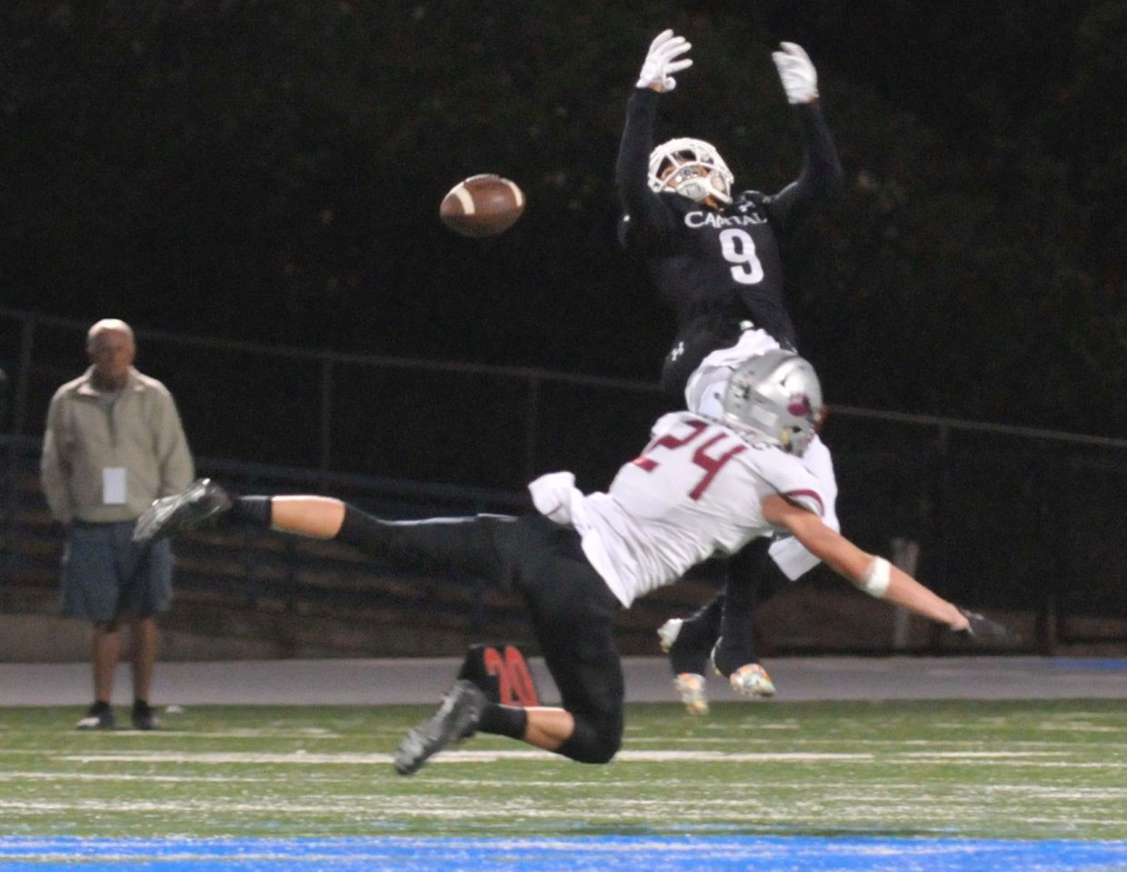 Bear River's Tre Maronic (24) flys through the air to break up a Capital Christian pass intended for Ishmael Rehberg.
