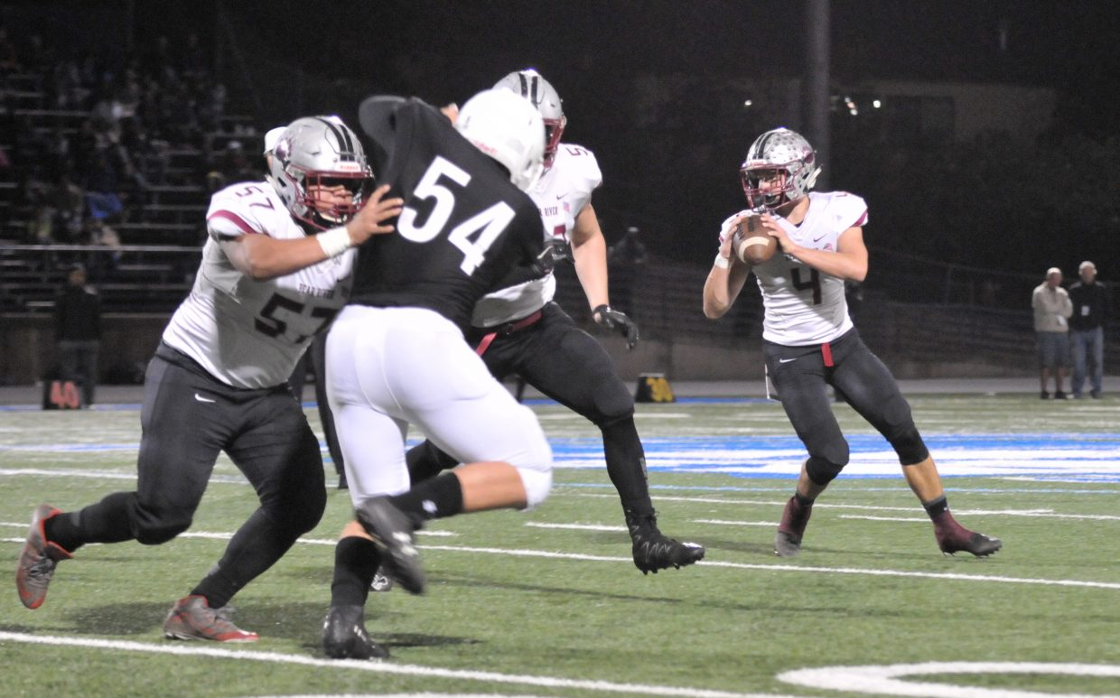 Bear River quarterback Luke Bagget (4) readies to throw a pass for the Bruins during Thursday night's first round playoff win over the Capital Christian Cougars.
