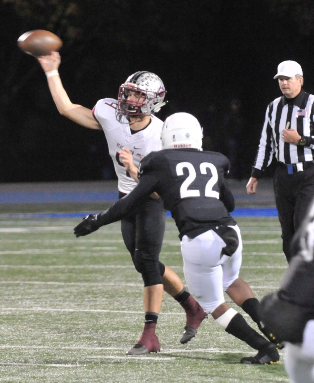 Bear River quarterback Luke Bagget (4) fires off a pass before getting tackled by the Capital Christian defense.