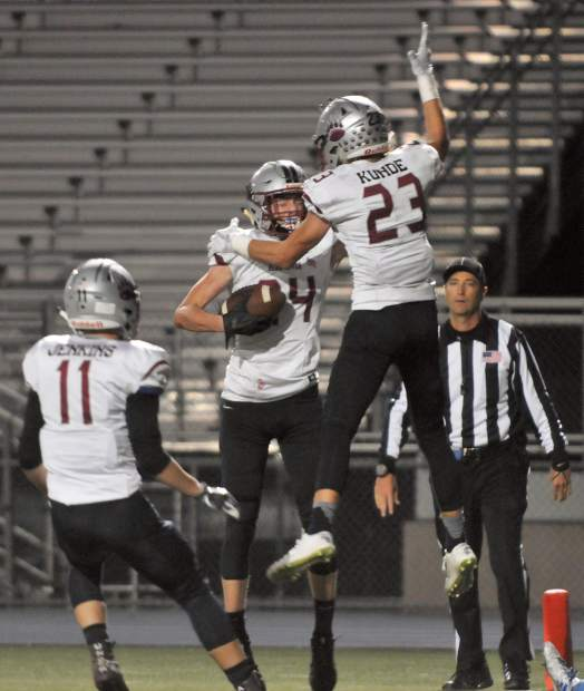 Bear River's Tre Maronic (24), Logan Jenkins (11) and Calder Kunde (23) celebrate after Maronic scored on a 24-yard reception. Maronic finished the game with three catches for 68 yards and a touchdown. He also hauled in a pass for a two-point conversion in overtime.