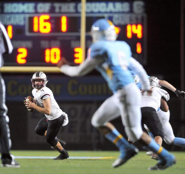 Bear River quarterback Luke Bagget looks down field for an open receiver to pass the ball to.
