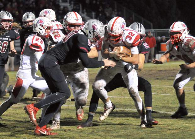Bear River defensive tackle Hayden Becker (50) goes head on against Ripon ball carrier Cameron Gamino (32) during the Bruin's 14-7 win over the Indians.