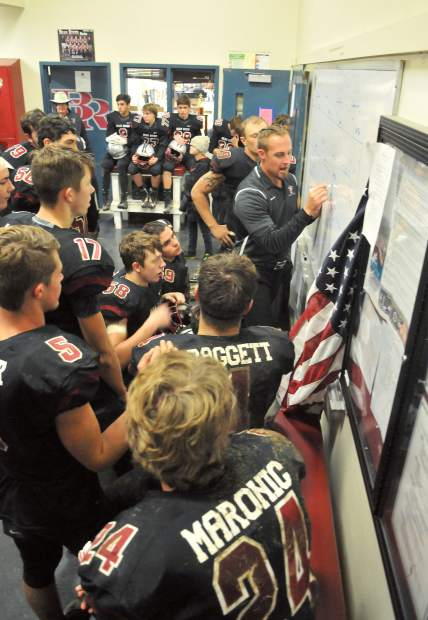 Bear River assistant coach Chad Quirarte goes over some halftime adjustments with the varsity Bruins in the locker room before finishing off the Ripon Indians during their second round Division V playoff game Friday at Bear River High School.