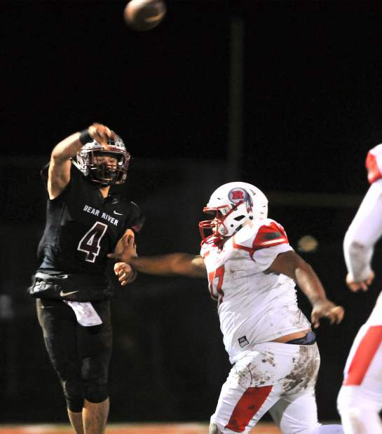 Bear River quarterback Luke Bagget gets a pass off under pressure of the Ripon Indians during their second round playoff win at home Friday night. Their 14-7 win sets the Bruins up for a Division V section title game against rival Colfax.