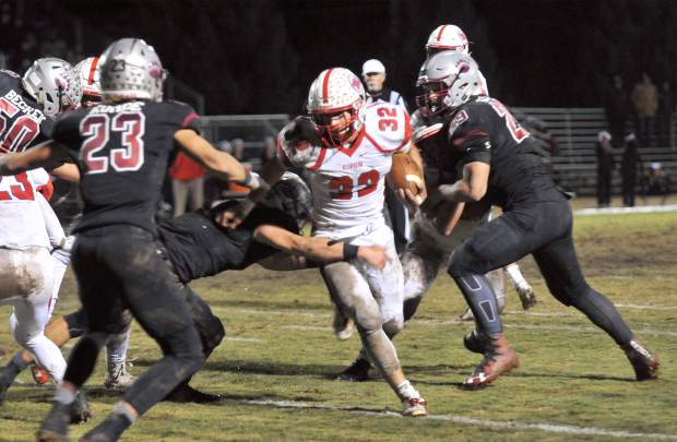 The Bear River defense looks to stop Ripon ball carrier Cameron Gamino (32) during the Bruin's 14-7 win over the Indians.