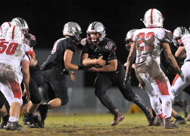 Bear River's Austin Baze (29) finds a hole as he is handed the ball from quarterback Luke Bagget (4) during the Bruins' 14-7 win over the Ripon Indians. Baze led the Bruins with 67 rushing yards, including a 12-yard touchdown run.