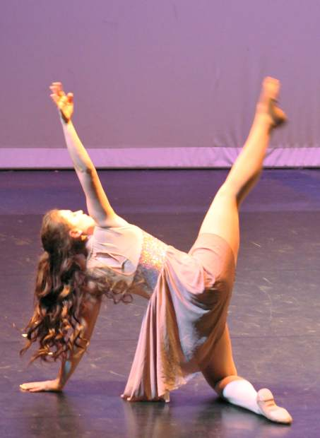 Nevada Union dancer Gracie Suenram dances on the stage at Don Baggett Theater to the Michael Jackson song