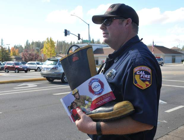 Cal Fire Station Captain Nathan Terrell out of the Columbia Hill location, stands on Brunswick Road Saturday for the Fill the Boot fundraising campaign to support the Muscular Dystrophy Association.