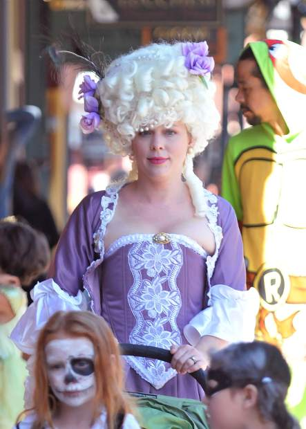 Mendocino's Julie Wood pushes a baby stroller down Mill Street dressed as Marie Antoinette Tuesday afternoon.