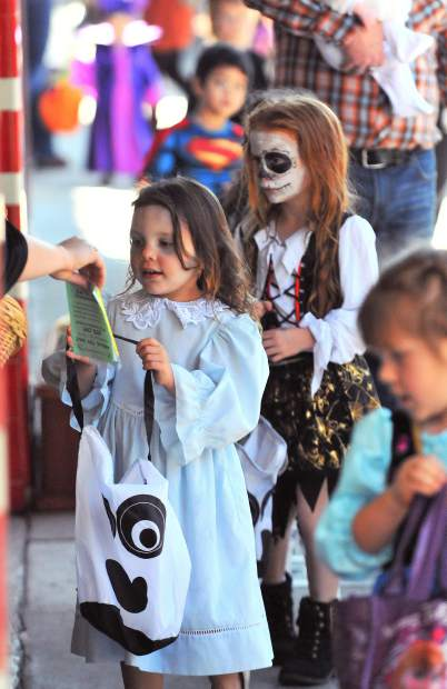Hundreds of youngsters dressed to the nines in their Halloween attire, lined Mill and Main Streets in downtown Grass Valley for a safe trick or treat event where a host of downtown business owners handed out candy and goodies.