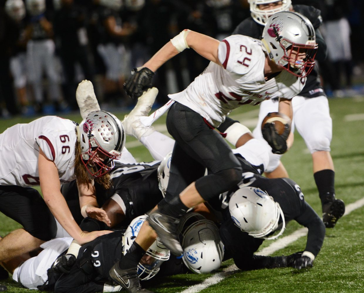 Bear River's Tre Maronic runs the ball during a playoff game against Capital Christian Thursday.
