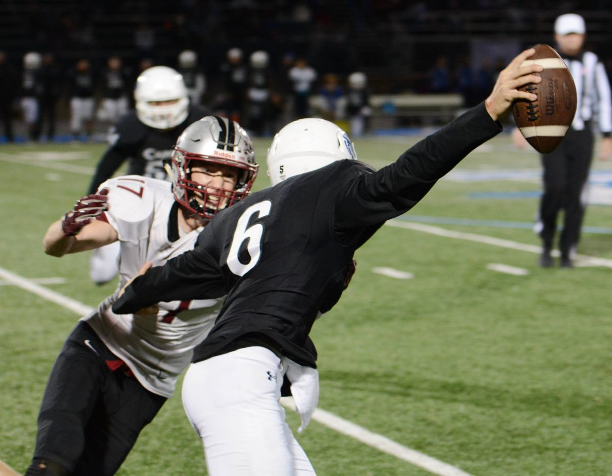 Bear River's Jake Leonard closes in on Capital Christian's quarterback during a playoff game Thursday.