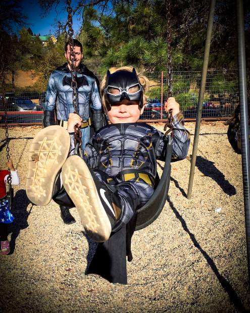 Kayden Wright and father Dustin Wright, both dressed as Batman, having some fun at a Lake Wildwood park on Halloween.