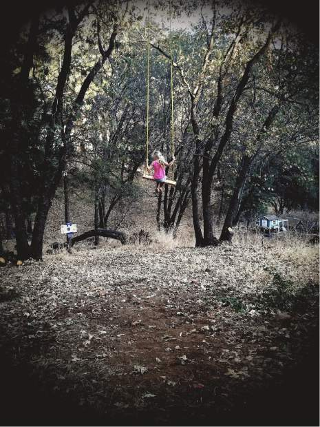 Photo submitted by John Roenspie of his daughter Alexis swinging on their rope swing in Alta Sierra.