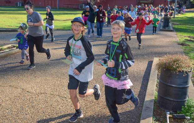 Grass Valley Charter Elementary School students and staff participated in this year's Walk-a-thon at the Nevada County Fairgrounds Friday morning to raise funds for a new shade structure for the school's lunch area.