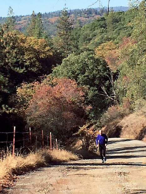 Gene Meyers running up Mt. Olive Road on a beautiful fall day.