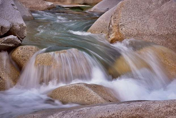 Water raging down boulders on the Yuba River.
