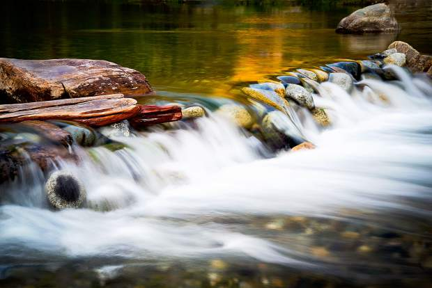 Recent photo of the Yuba River flowing at sunset.