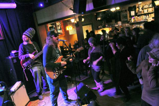 Folks groove to the tunes of the Sirus B Posse Saturday night at the Chief Crazy Horse Saloon in downtown Nevada City.