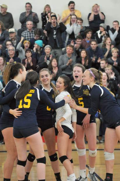 The Nevada Union Lady Miners celebrate a point along with the home crowd Wednesday.
