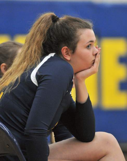 Nevada Union's Meadow Aragon watches intently from the sideline as her team struggles against Chico High School. Eventually Aragon and the rest of the team would celebrate their five set victory over the Panthers.