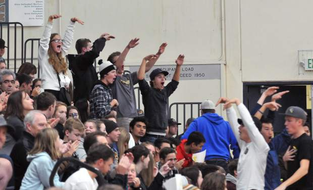 The Nevada Union Miners home crowd gets into the spirit as they celebrate one of the Lady Miners' final points before winning the match in five sets.