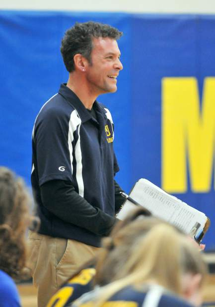 Nevada Union Lady Miners head coach Chrys Dudek smiles from the sideline during NU's win over the Chico Panthers.