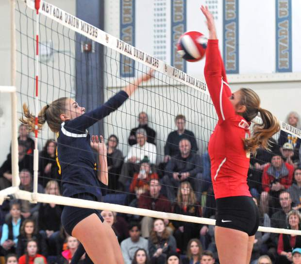 Chico High School's Adair Hotmer blocks Bekah McGill's hit during the Miners' CIF NorCal Division 2 tournament matchup against the Panthers. The Miners would have to overcome many blocked shots by the Panthers en route to their five set victory Wednesday night.